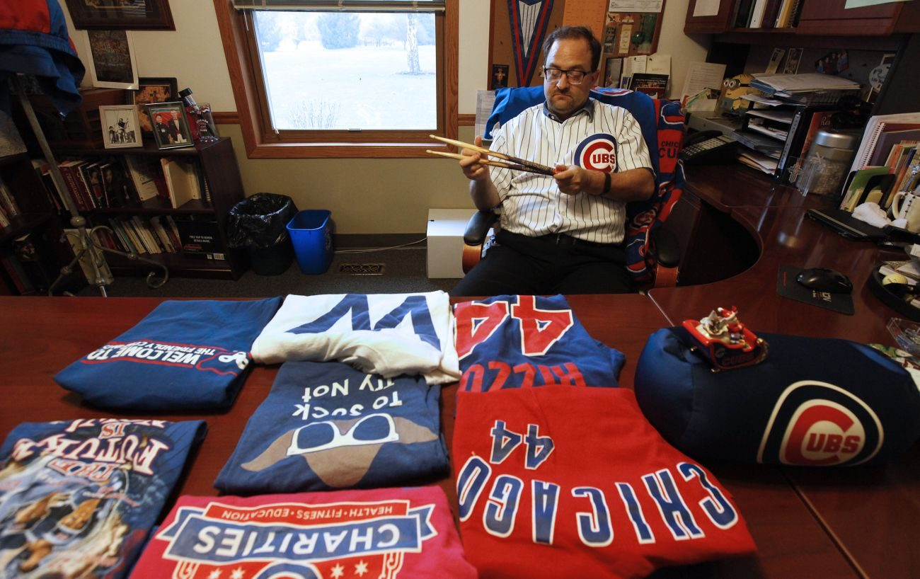 Father Michael Novick, pastor of St. Lawrence O'Toole in Matteson, Ill., shows off his Cubs gear Oct. 27. (Karen Callaway/Catholic New World)