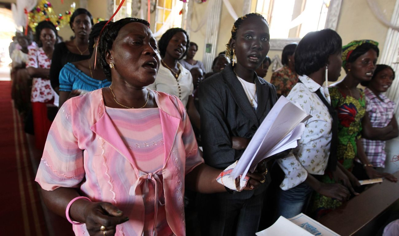"People pray in 2011 at a Catholic church in Juba, South Sudan. The Sudan Catholic Bishops' Conference, which includes the bishops of Sudan and South Sudan, said ""there is nothing more needed than forgiveness"" to heal the differences both countries have experienced for decades. (CNS photo/Mohamed Messra, EPA)"