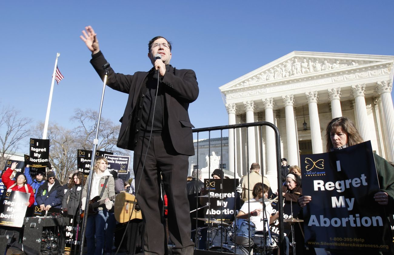 Father Frank Pavone, national director of Priests for Life, speaks in front of the U.S. Supreme Court at the 2009 March For Life in Washington. Pro-life supporters have denounced Father Pavone over a controversial election Facebook Live video he posted. (CNS photo/Bob Roller)