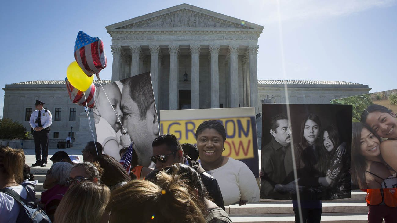 Supporters of the Deferred Action for Childhood Arrivals program, known as DACA, are seen outside the U.S. Supreme Court in Washington April 18. More than 70 presidents at Catholic colleges and universities have signed a statement pledging their support for students attending their schools who are legally protected by DACA. (CNS photo/Tyler Orsburn)
