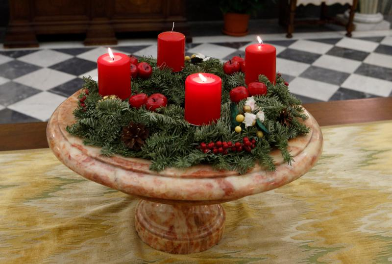 An Advent wreath decorates the Apostolic Palace at the Vatican Dec. 14, 2015. Catholics regard Advent as a season of preparation and expectation, of promise and hope. (CNS photo/Paul Haring)