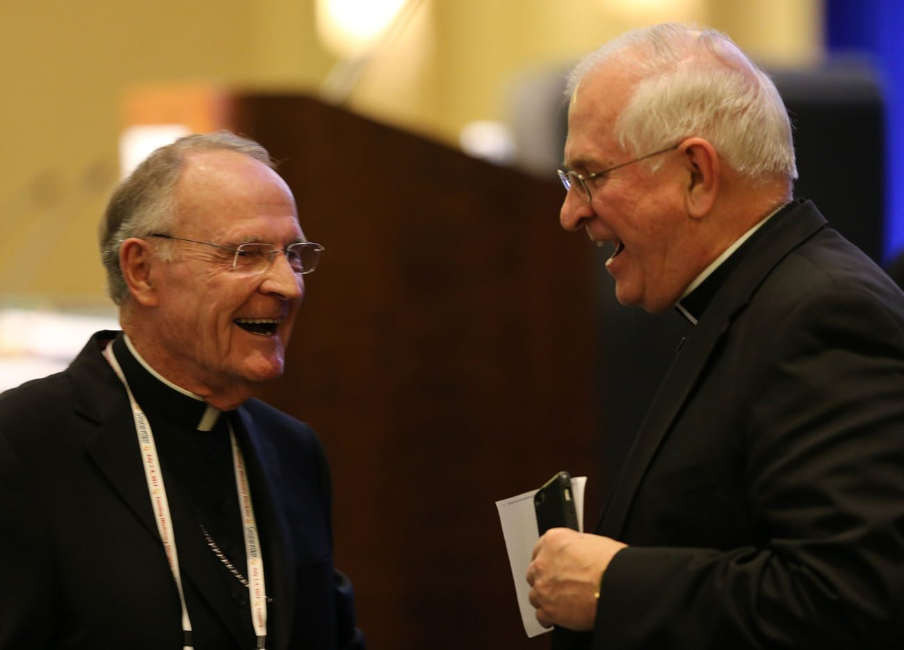 Archbishop Joseph E. Kurtz of Louisville, Ky., outgoing president of the U.S. Conference of Catholic Bishops, speaks with another prelate Nov. 14 during the bishops' annual fall general assembly in Baltimore. (CNS photo/Bob Roller) .