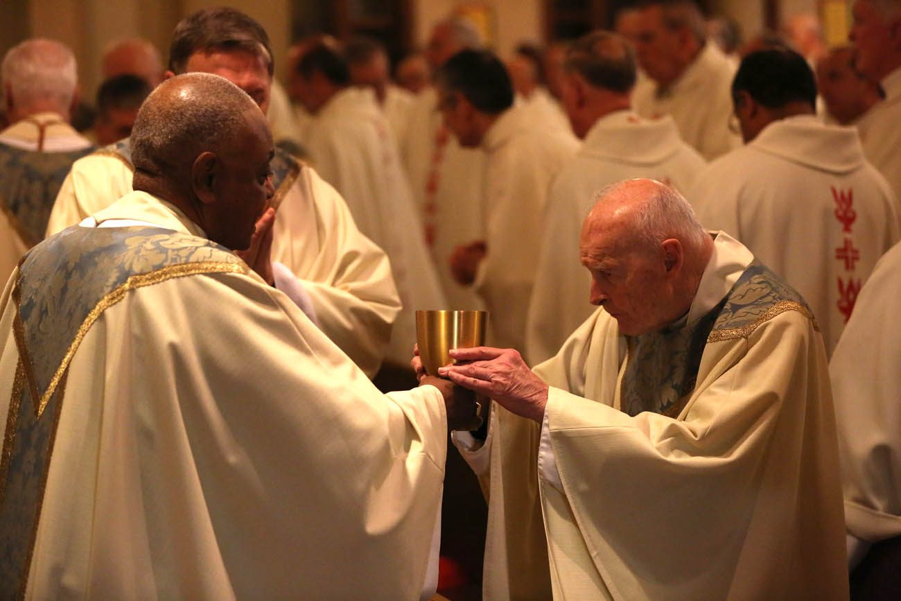 Atlanta Archbishop Wilton D. Gregory hands the chalice to Cardinal Theodore E. McCarrick, retired archbishop of Washington, during Communion at Mass at St. Peter Claver Church in Baltimore Nov. 14 during the annual fall general assembly of the U.S. Conference of Catholic Bishops. (CNS photo/Bob Roller)