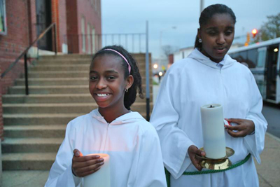 Altar servers stand outside St. Peter Claver Church in Baltimore before Mass Nov. 14. The U.S. bishops' traditional Mass for their annual fall general assembly was celebrated at the historic African-American church. (CNS photo/Bob Roller)