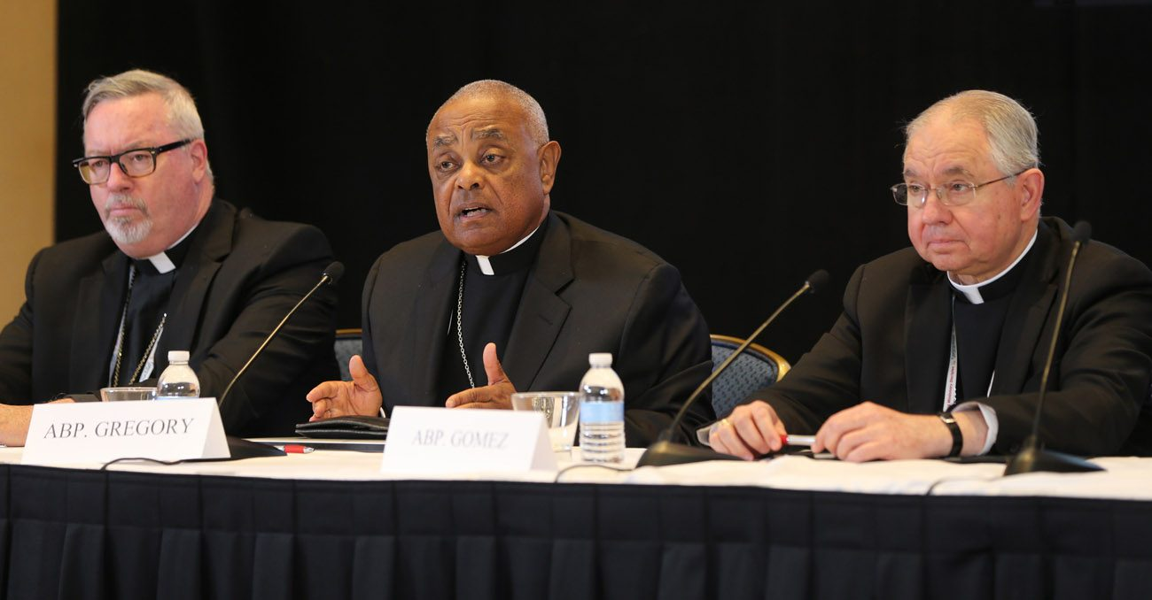 Atlanta Archbishop Wilton D. Gregory, center, speaks during a news conference Nov. 14 during the annual fall general assembly of the U.S. Conference of Catholic Bishops in Baltimore. At left is Bishop Christopher J. Coyne of Burlington, Vt., and at right is Archbishop Jose H. Gomez of Los Angeles. (CNS photo/Bob Roller)