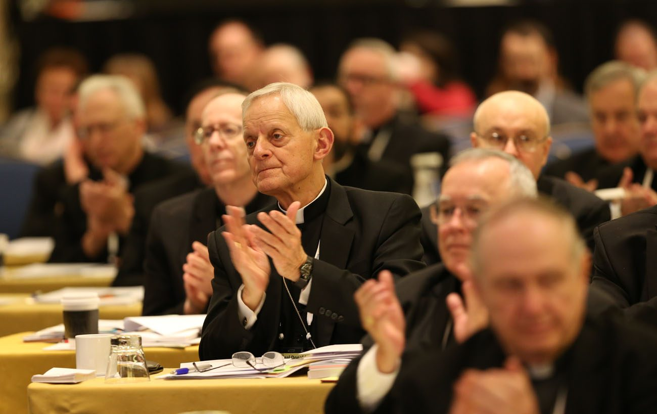 Washington Cardinal Donald W. Wuerl, center, applauds with other prelates Nov. 14 during the annual fall general assembly of the U.S. Conference of Catholic Bishops in Baltimore. (CNS photo/Bob Roller)