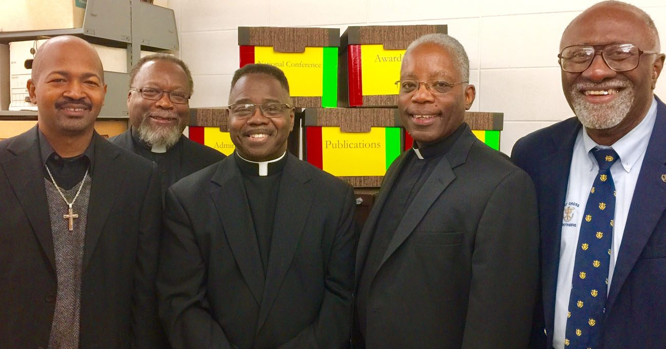 Black priests pose for a photo at the Theodore Hesburgh Library on the campus of the University of Notre Dame in South Bend, Ind., Oct. 25. The delegation members are Deacon Melvin Tardy of Notre Dame, Father Theodore Parker of the Archdiocese of Detroit, Father Clarence Williams of the Diocese of Columbus, Ohio, Father Kenneth Taylor of the Archdiocese of Indianapolis and Holy Cross Brother Roy Smith of Notre Dame. (CNS photo/courtesy Catholic African World Network)