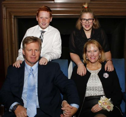 Donna Crilley Farrell poses Nov. 18 at the 2016 Barry Award dinner with her family including husband Michael Farrell, son Connor and daughter Christina. (Sarah Webb)