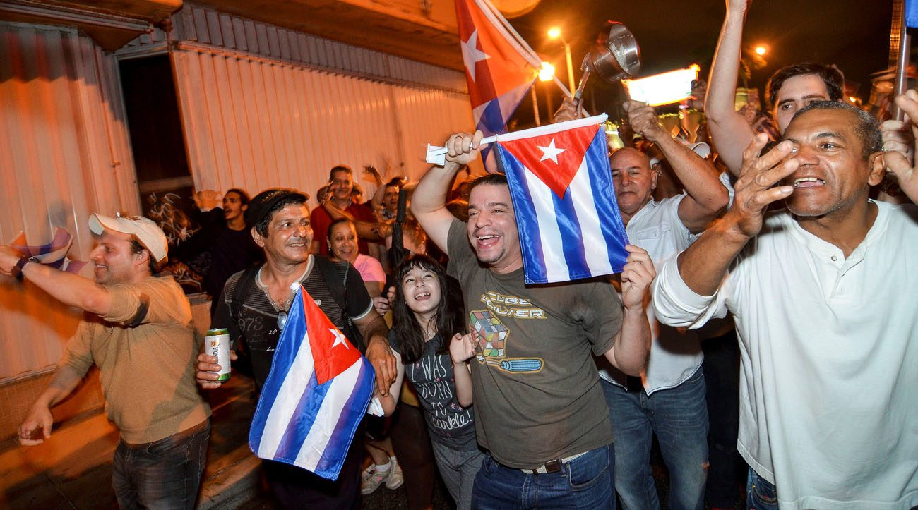People celebrate the death of Cuban leader Fidel Castro in Little Havana, a neighborhood of Miami, Nov. 26. Castro, who seized power in a 1959 revolution and governed Cuba until 2006, died Nov. 25 at the age of 90. (CNS photo/Gaston De Cardenas, Reuters)