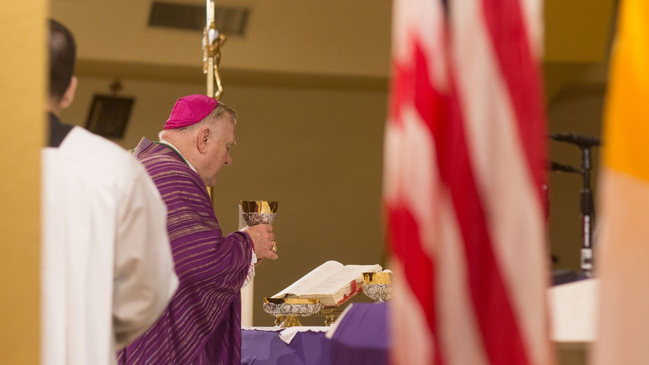Miami Archbishop Thomas G. Wenski celebrates Mass Nov. 26 at the National Shrine of Our Lady Charity in Miami. The death of former Cuban leader Fidel Castro triggered both excitement and a more subdued reaction among Cuban exiles in Miami. (CNS photo/Tom Tracy)