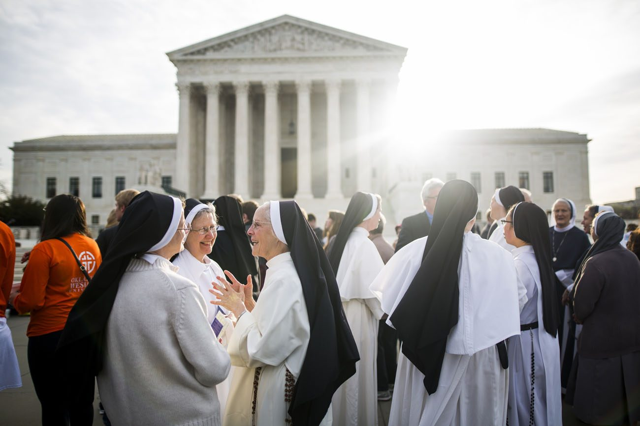 Women religious gather outside the U.S. Supreme Court in Washington March 23, the day the high court heard oral arguments in religious groups' suit against the Affordable Care Act's contraceptive mandate. (CNS photo/Jim Lo Scalzo, EPA)