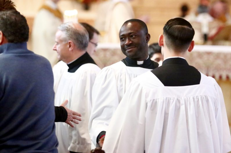 Martin O. Okwudiba offers fellow seminarians a sign of peace.
