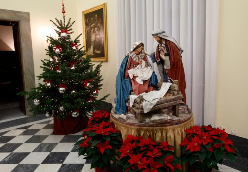 "A Nativity scene and Christmas tree decorate the Apostolic Palace at the Vatican Dec. 15, 2014. The familiar scene of Jesus lying in a manger, tended by Mary and Joseph, points beyond itself to remind believers that this child is the Word of God, who ""became flesh and made his dwelling among us"" (Jn 1:14). (CNS photo/Paul Haring)"