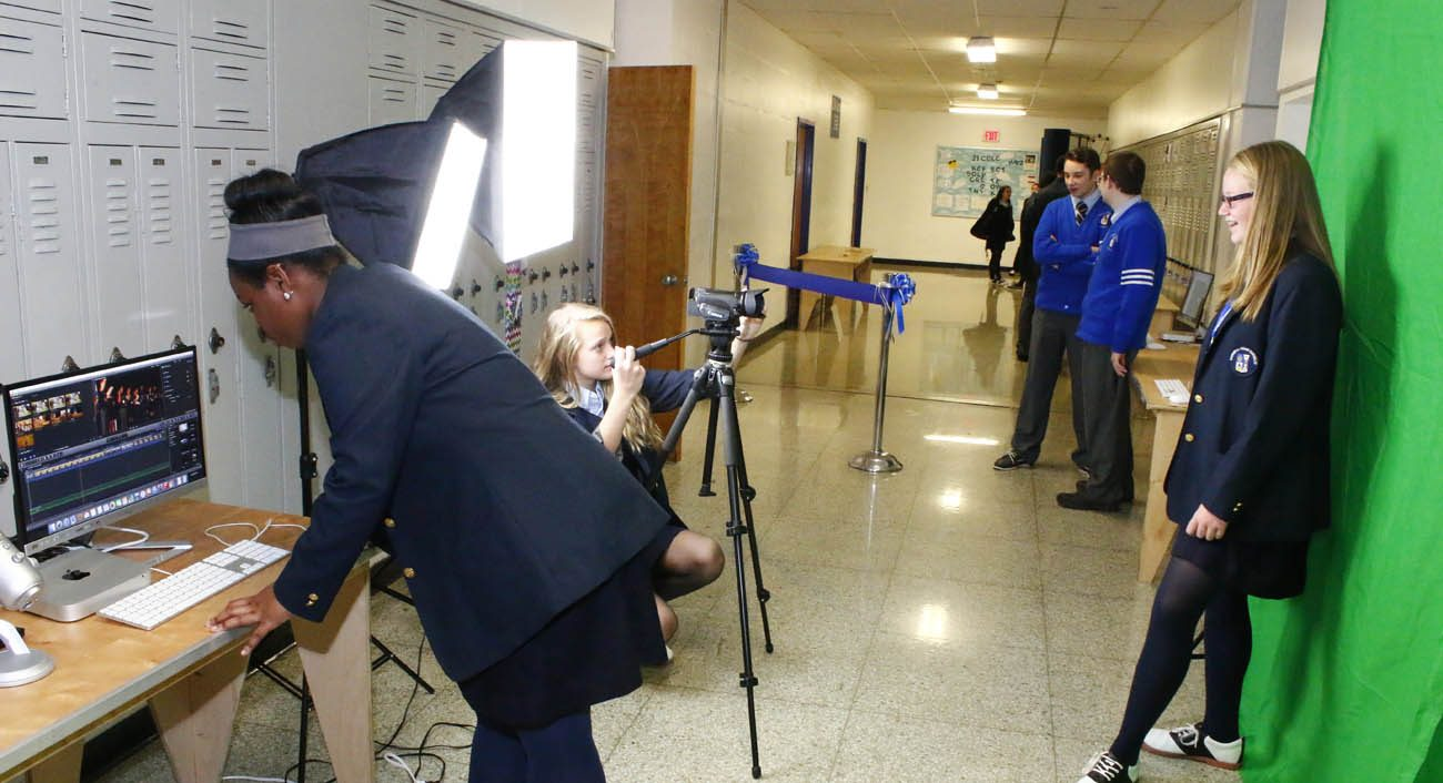 During a Nov. 16 event for visitors to Conwell-Egan Catholic High School, freshman students Angel Crowell, Delaney Lindberg and Sara Stintsman from the EAST Program show how to film using a green screen, digital camera and a computer.