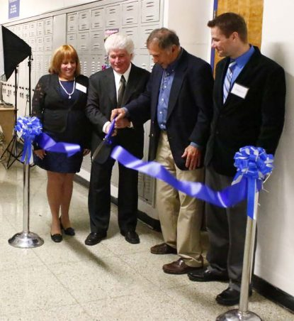 School officials and family members of the late Bonnie Gray, a Conwell-Egan graduate, dedicate the new EAST Program lab at the school Nov. 16 in her memory.