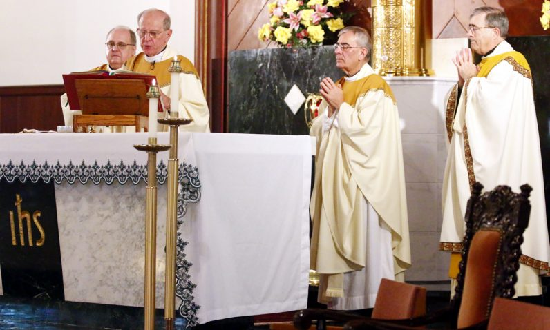 Priests celebrating the Mass include (from left) Servant of Charity Father Dennis Weber, Msgr. Richard Bolger, Msgr.  John Savinski and Father Francis Mulranen.