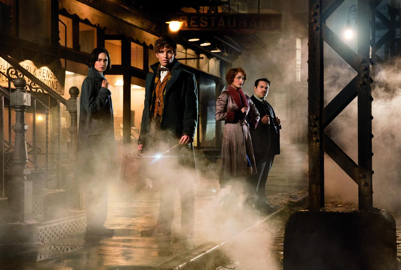 """Katherine Waterston, Eddie Redmayne, Alison Sudol and Dan Fogler star in a scene from the movie """"Fantastic Beasts and Where To Find Them.""""  (CNS photo/Warner Bros. Entertainment)"""