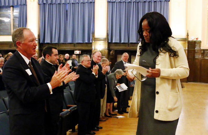 West Catholic Preparatory High School graduate Jasmine Mays (class of 2016) receives a standing ovation from the Faith in the Future Foundation's guests after being brought to tears during her testimony on the benefits of her Catholic education. (Photo by Sarah Webb)
