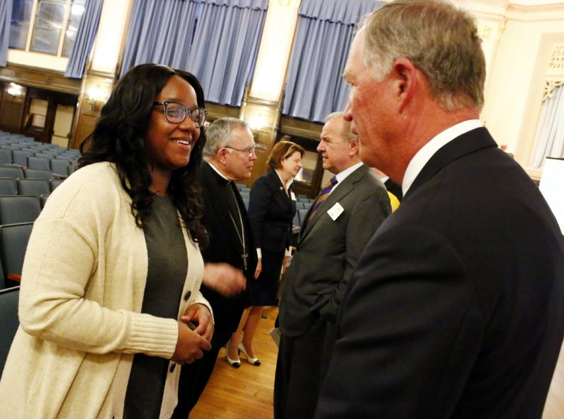 West Catholic alum Jasmine Mays chats with Edward Hanway, Faith in the Future chairman, after the event.