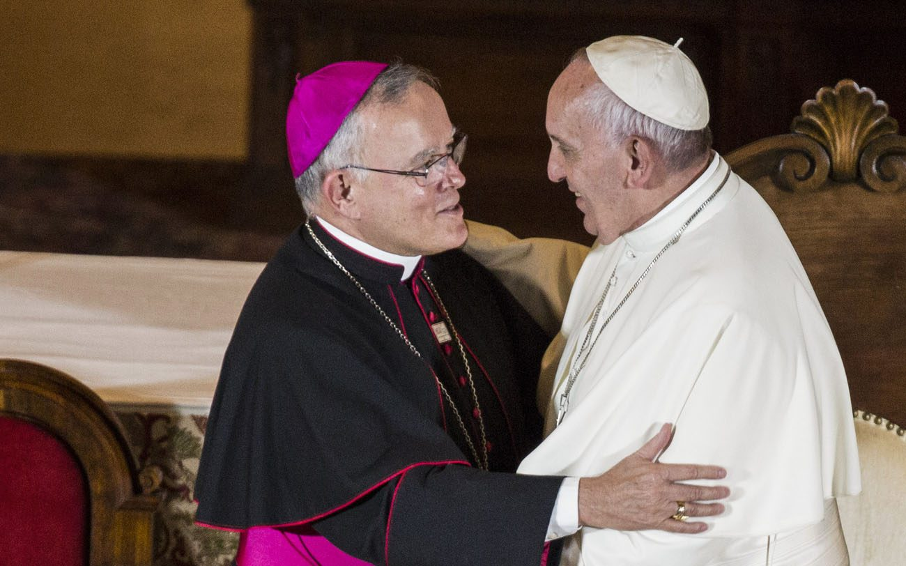 Pope Francis and Archbishop Charles J. Chaput of Philadelphia embrace during the pope's meeting with church leaders at St. Charles Borromeo Seminary in Wynnewood, Pa., Sept. 27, 2015. (CNS photo/Joshua Roberts) .