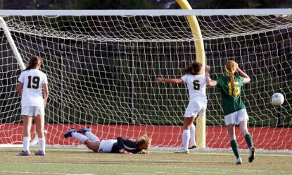 The falls into the back of the net on the final play of the game, a header off a penalty kick, during the Catholic League championship Oct. 29 in South Philadelphia. Sarah Webb)