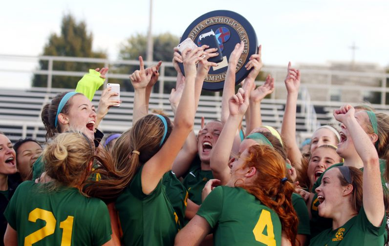 Archbishop Wood hoists their Catholic League plaque after a thrilling 2-1 overtime win over Lansdale Catholic Oct. 29. (Sarah Webb)
