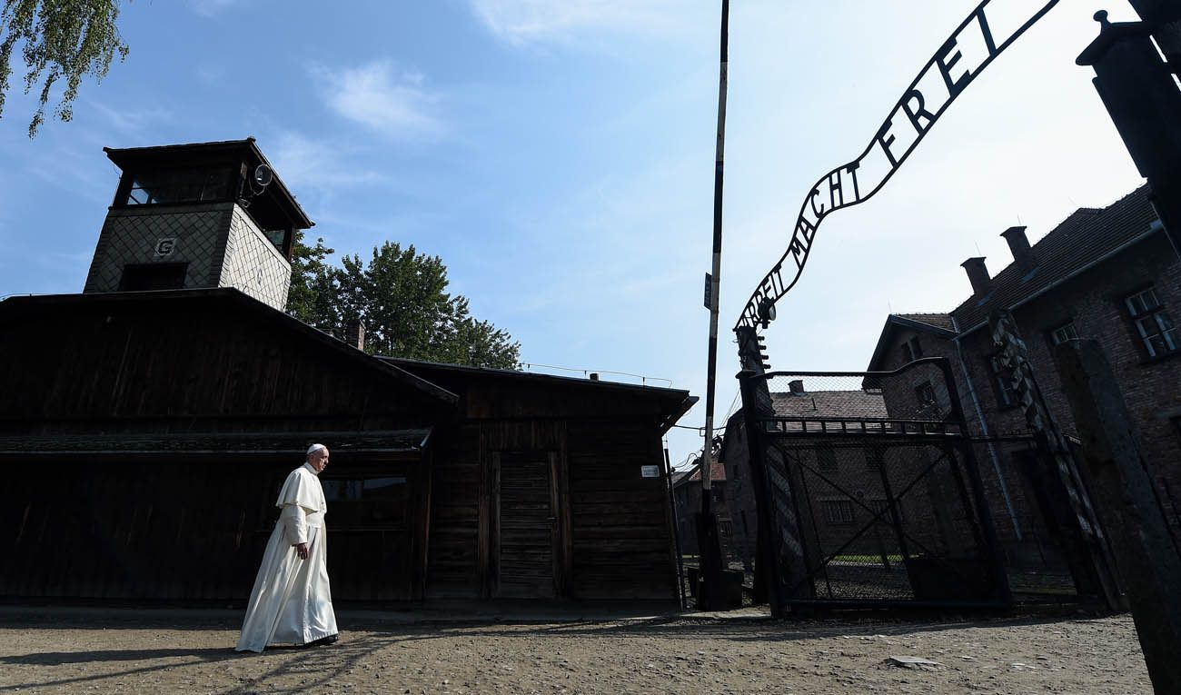 "Pope Francis enters the main gate of the Auschwitz Nazi death camp in Oswiecim, Poland, July 29. Following a joint visit to the camp in Poland in early November, Israeli religious leaders urged world leaders to act with ""unwavering resoluteness"" against the anti-Semitism and hatred toward others becoming more prevalent in today's society. (CNS photo/Alessia Giuliani, pool)"
