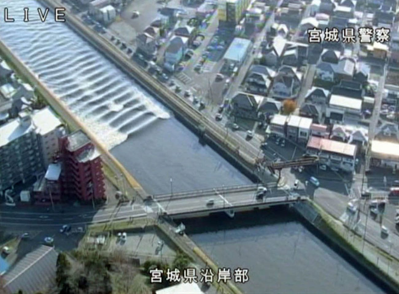 A tidal surge is seen in this video grab of Sunaoshi River after tsunami advisories were issued following an earthquake in Tagajo, Japan, Nov. 22. (CNS photo/ Miyagi Prefectural Police via Reuters)