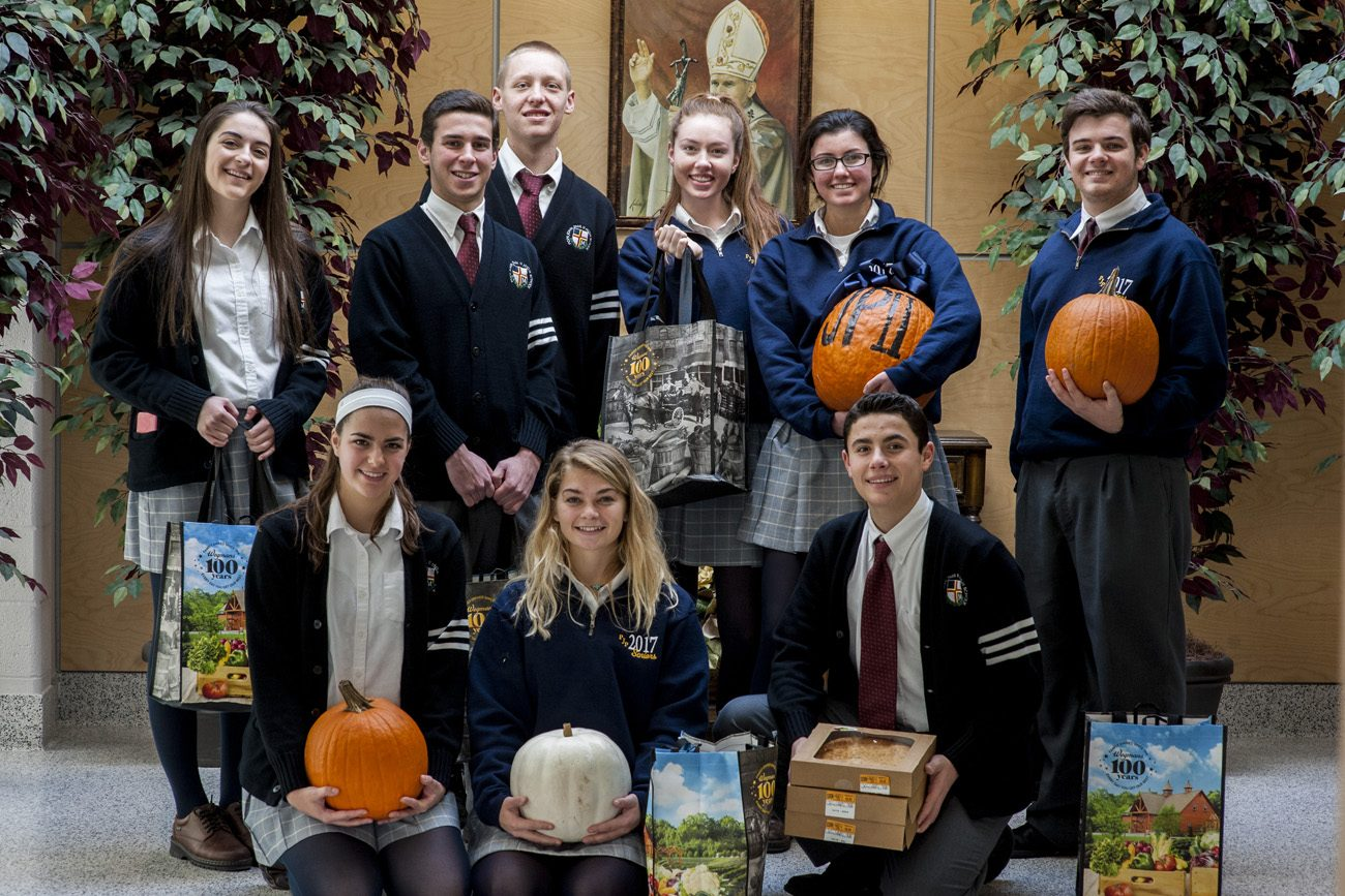 Students of Pope John Paul II High School show some of the Thanksgiving meals they collected for local families this Thanksgiving.
