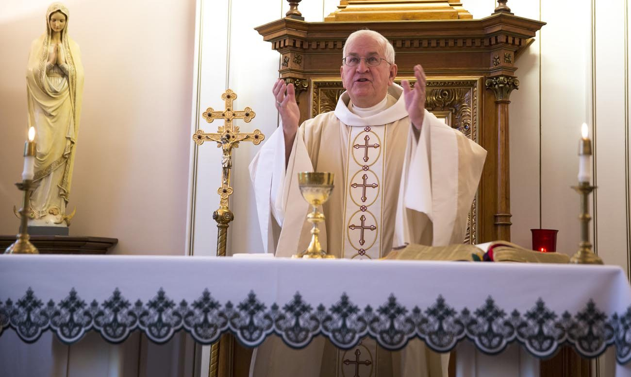 Archbishop Joseph E. Kurtz of Louisville, Ky., celebrates a Nov. 4 morning Mass in a chapel in the chancery of the Archdiocese of Louisville. (CNS photo/Chaz Muth)