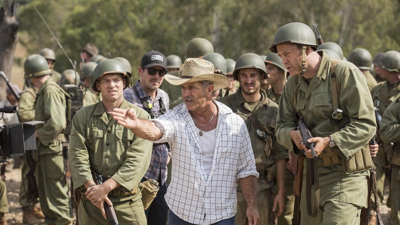 "Director Mel Gibson, center, is seen on the set of ""Hacksaw Ridge."" The movie marks Gibson's return to the director's chair after a 10-year absence. (CNS photo/Lionsgate)"
