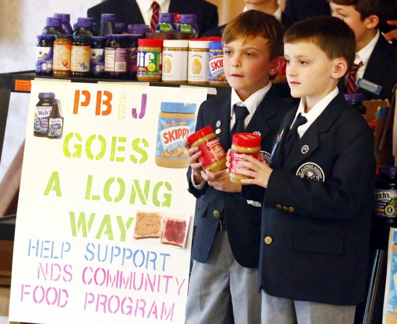 Shawn Rinnier (left) and Jack Gress collected the most jars which helped St. Aloysius Academy surpass its 500-jar goal.