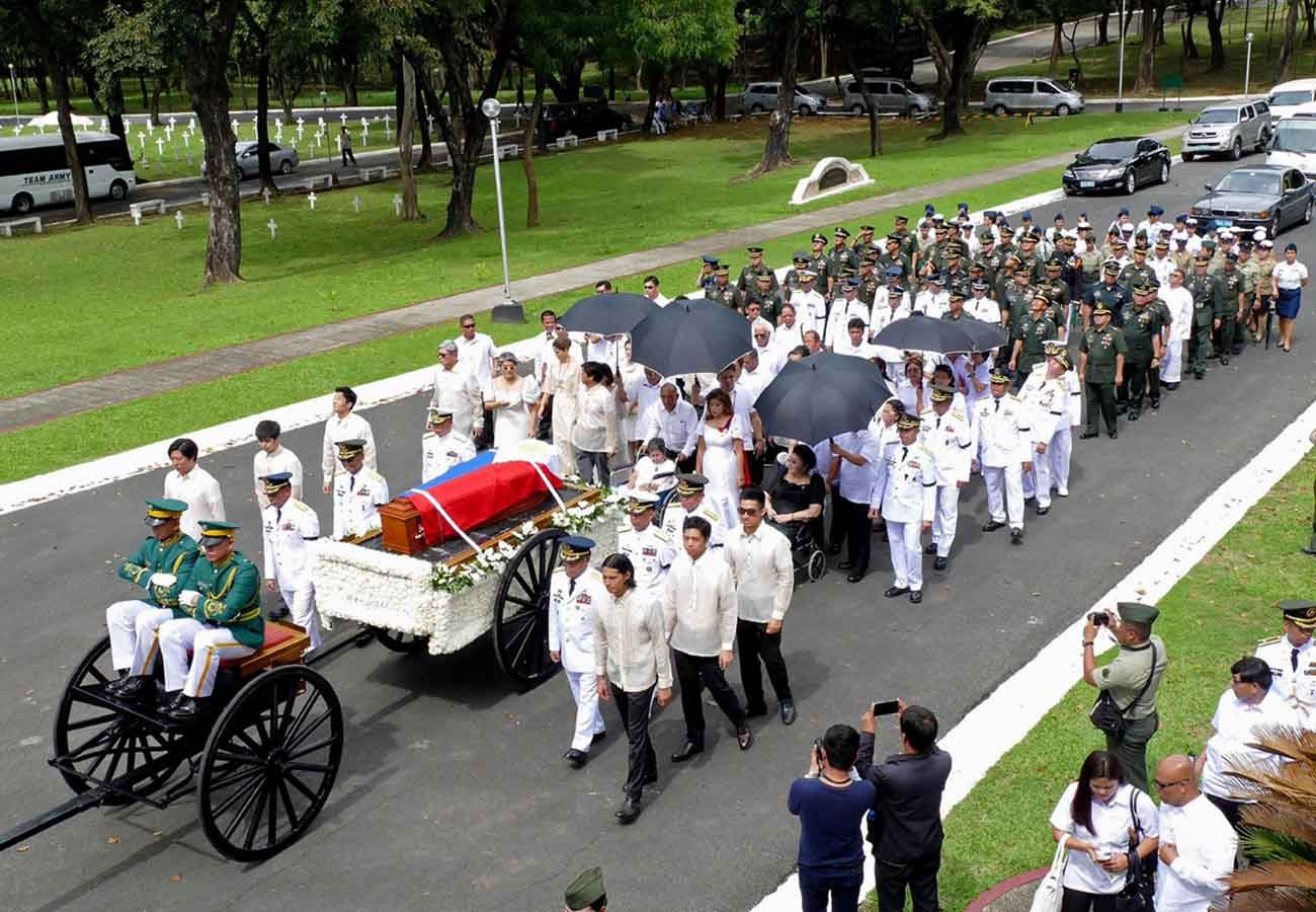 The flag-draped coffin of former Philippine dictator Ferdinand Marcos is seen atop a military hearse in Manila Nov. 18. (CNS photo/Stringer, Reuters)