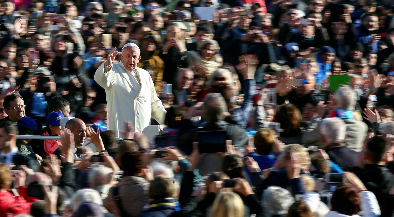 Pope Francis waves as he arrives to lead his general audience in St. Peter's Square Nov. 16. (CNS photo/Alessandro Bianchi, Reuters)