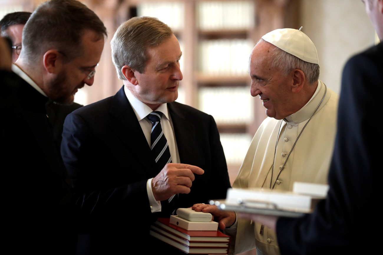 Pope Francis exchanges gifts with Irish Prime Minister Enda Kenny during a private audience at the Vatican Nov. 28. (CNS photo/Alessandra Tarantino, Reuters pool)