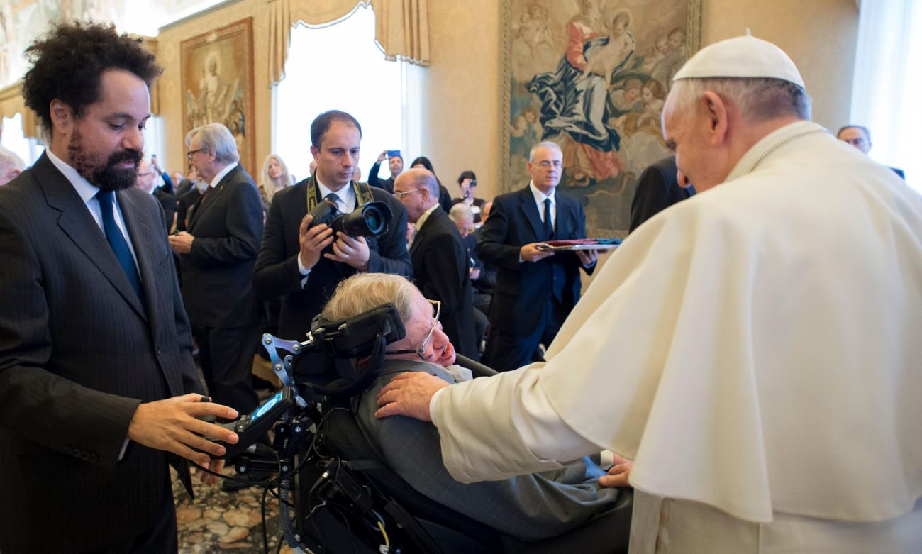 Pope Francis greets British theoretical physicist and cosmologist Stephen Hawking, during an audience with participants attending a plenary session of the Pontifical Academy of Sciences at the Vatican Nov. 28. (CNS photo/L'Osservatore Romano, handout)