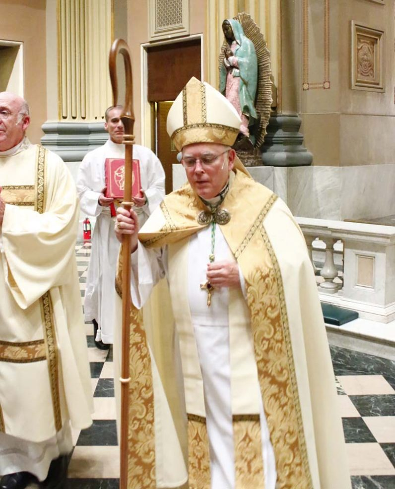 Archbishop Chaput processes into the Cathedral Basilica of SS. Peter and Paul for the start of the Liturgy of the Word.