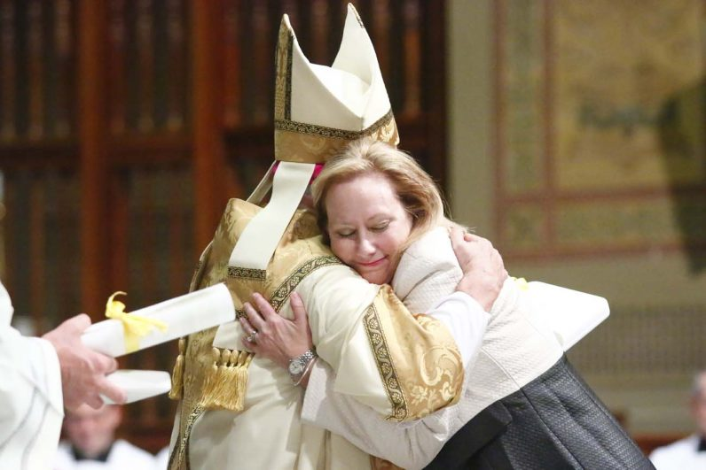 Donna Farrell, recipient of the Benerementi Medal, shares a warm moment with Archbishop Chaput after receiving her award.