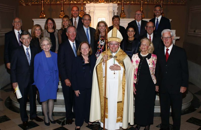 The Dames and Knights in the Order of St. Gregory the Great pose with Archbishop Chaput after receiving their papal honors Nov. 17 at the cathedral.