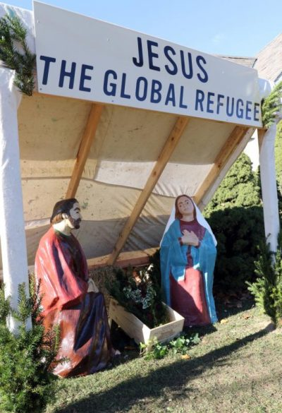 "A creche titled ""Jesus the Global Refugee"" is seen outside Our Lady of the Miraculous Medal Church in Wyandanch, N.Y., Nov. 27. The structure, designed as a refugee's lean-to, was created to call public attention to the biblical mandate to welcome immigrants and give shelter to refugees. (CNS photo/Gregory A. Shemitz)"