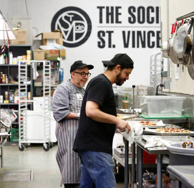 Chris Hoffman, executive chef for the Society of St. Vincent de Paul in Phoenix, keeps calm as he and his staff prepare meals Nov. 17. His staff and volunteers prepare 4,500 meals a day and will do more for Thanksgiving and Christmas. (CNS photo/Nancy Wiechec)