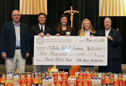 Students raised $10,000 to support Catholic Relief Services' efforts in Haiti and presented a check in that amount to CRS at the school Nov. 22. Shown from left: Principal Michael McArdle; Patrick McNulty, Student Council president; Cheryl Mrazik of CRS; Kelly McGlone, Student Council vice-president; and President Sister Regina Plunkett, I.H.M.