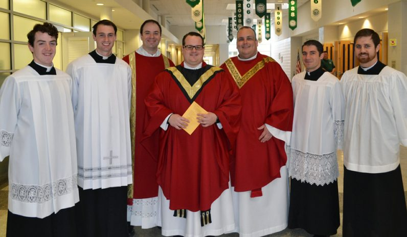 Celebrating Bishop Shanahan's Thanksgiving Mass Nov. 22 were archdiocesan priests and seminarian graduates of the school including (from left): Eric Tamney, class of 2013; David O'Brien, '10; Deacon Brian Connelly, '94; the Liturgy's main celebrant, Father Mark Cavara, '05; school minister Father John Donia; Alessandro Giardini, '10; and Gus deSimone, '07.