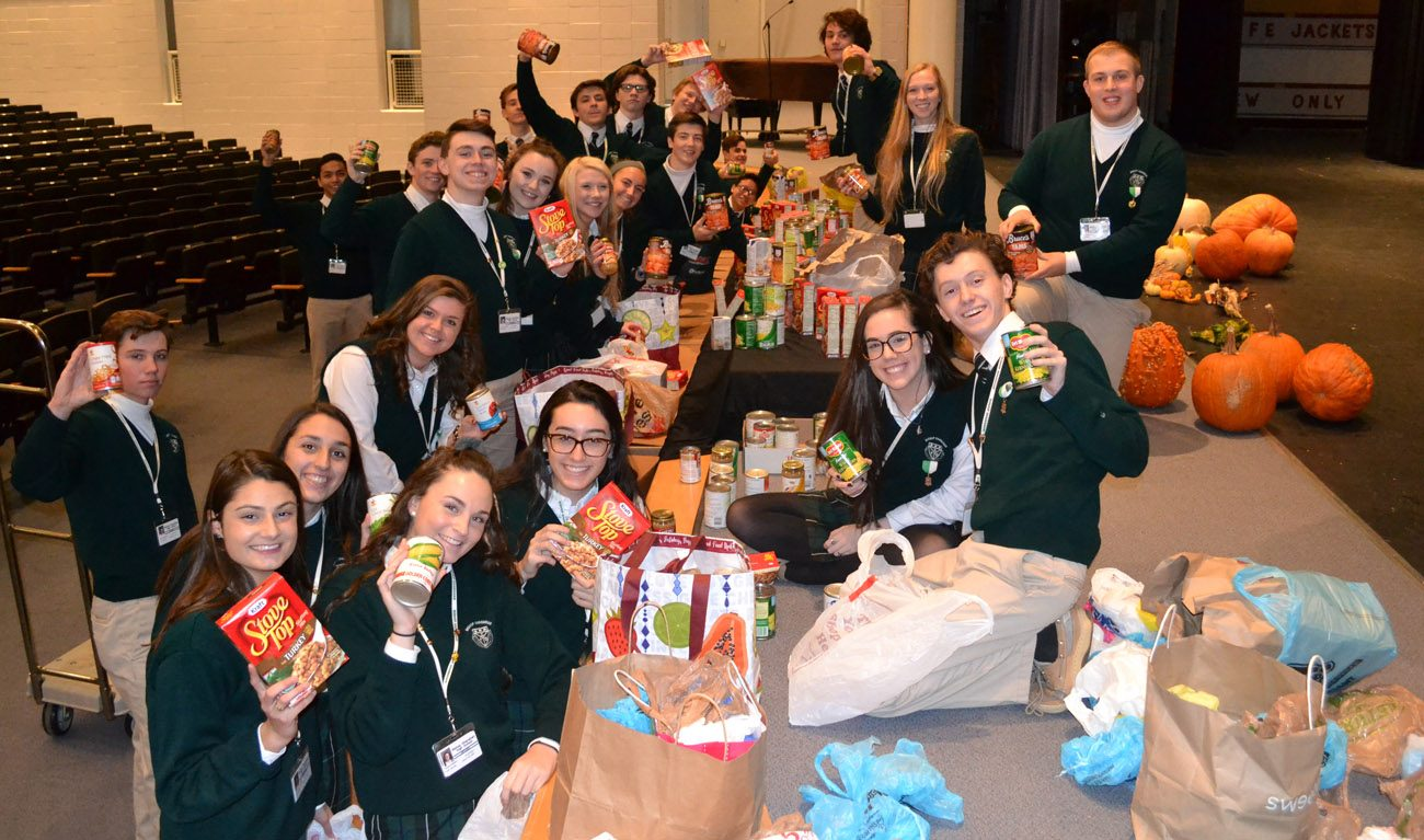 Bishops Shanahan High School students pack Thanksgiving Day meal bags for 30 families in communities in Chester County.