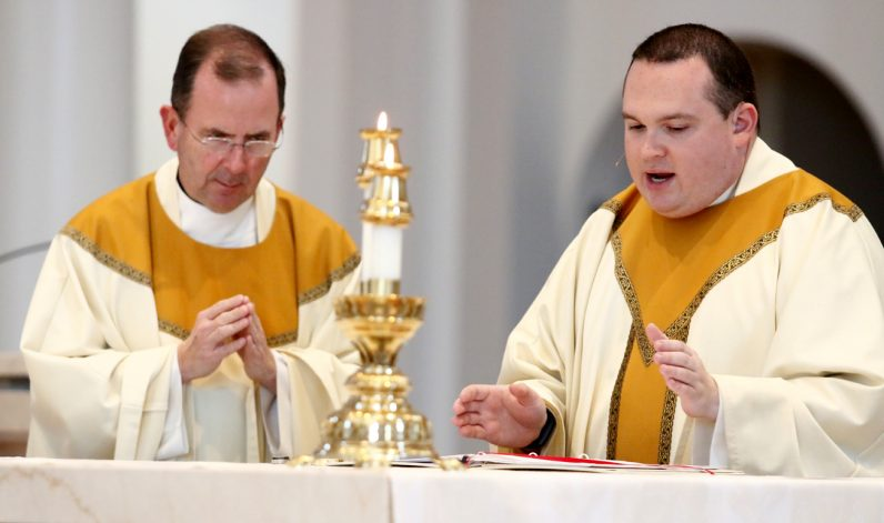 Msgr. Joseph McLoone and Father Anthony Rossi concelebrate Mass for the sick at St. Joseph Church in Downingtown.