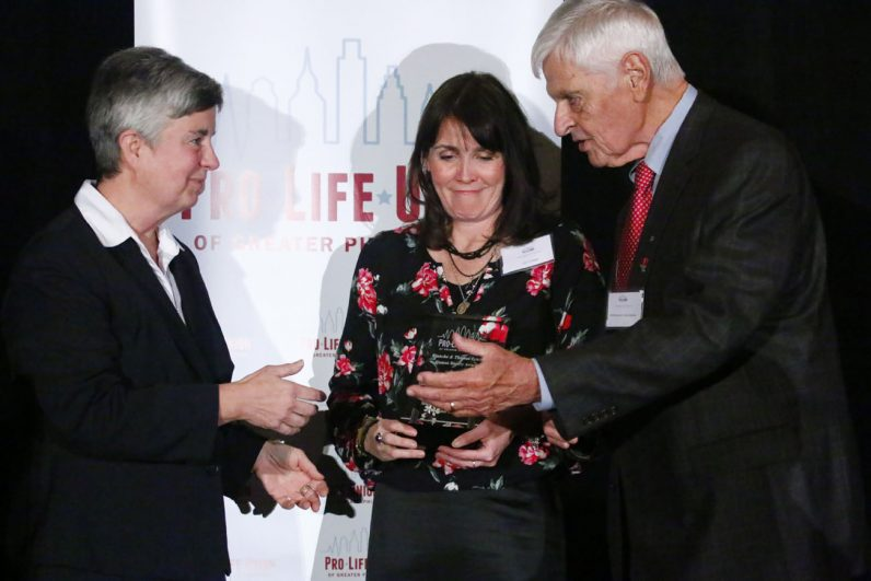 At left, Sister Kathleen Schipani, I.H.M., accepts an award from Edel Finnegan and Bill Wohlgemuth of the Pro-Life Union for her work with persons with disabilities.