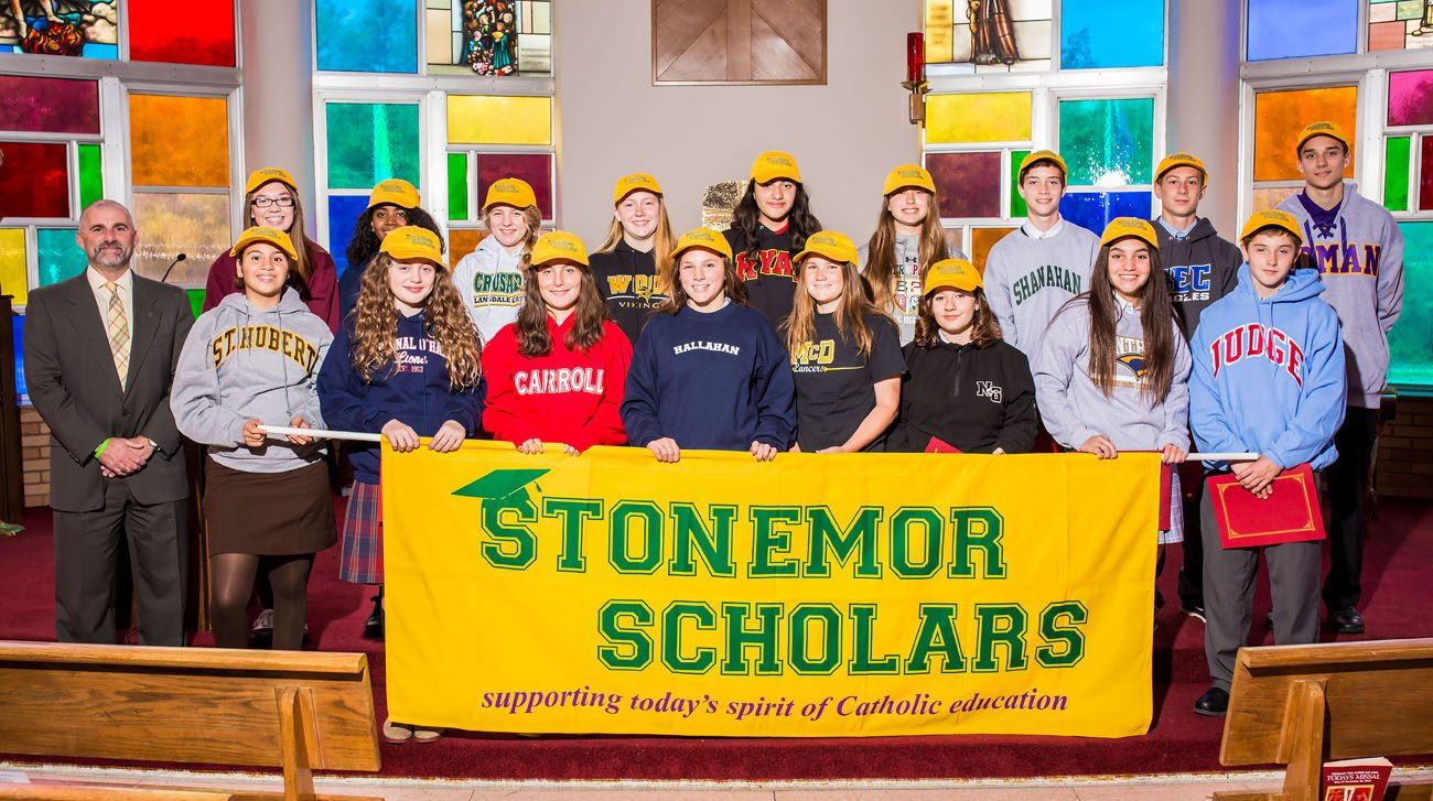 For the second year StoneMor Partners has awarded $3,000 scholarships to a freshman student at each of the 17 Catholic high schools in the Archdiocese of Philadelphia. Shown at left with the scholarship winners Oct. 14 at Archbishop Ryan High School is Jonathan Ger of StoneMor Partners.