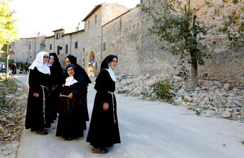 Nuns stand next a partially collapsed wall Oct. 30 following an earthquake in Norcia, Italy. (CNS photo/Remo Casilli, Reuters)