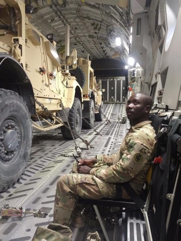 Father Charles Awotwi, a priest of the Diocese of Salina, Kan., is seen aboard a C-17 transport with the U.S. Army in this undated photo. He is currently a military chaplain serving with U.S. troops stationed in the Middle East. (CNS photo/courtesy The Register)