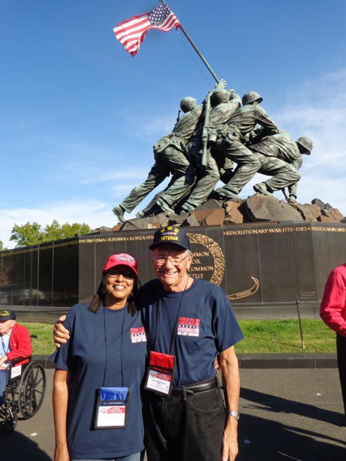 World War II veteran Carl Muscarello of All Saints Parish in Sunrise, Fla., and his guardian, Sandy Thomas, pose Oct. 29 in front of the Iwo Jima Memorial in Arlington, Va., across the Potomac River from Washington. (CNS photo/courtesy The Florida Catholic)